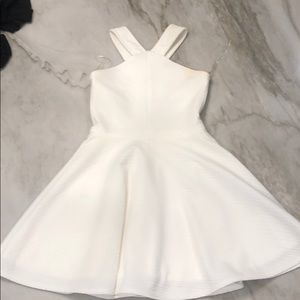 This is a very pretty white dress (size medium)